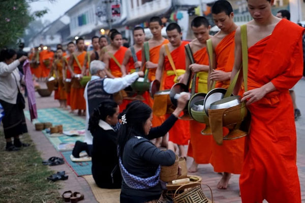 Experience the special alms ritual in the ancient city Luang Prabang.