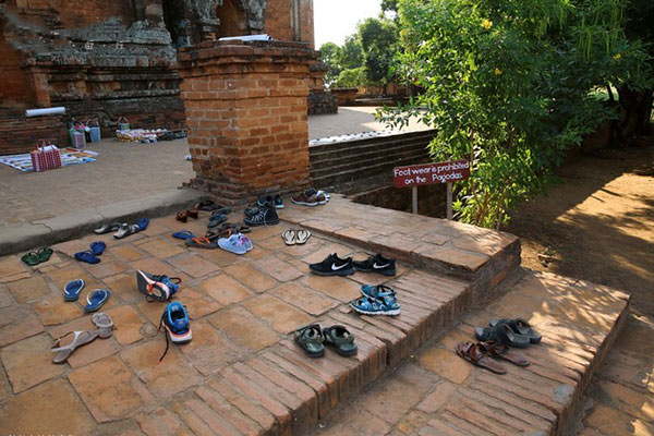 In the Pagodas, enter barefooted and decently dressed